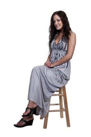 stool: A beautiful young woman looking far away