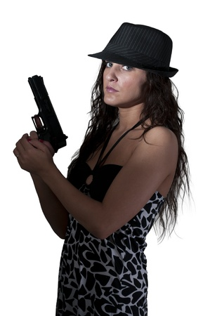 A beautiful police detective woman on the job with a gun photo