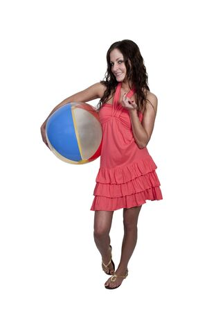 A beautiful young woman holding a beachball photo