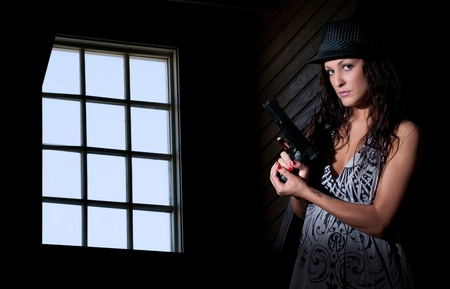 A beautiful police detective woman on the job with a gun Stock Photo - 13544778