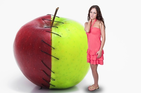 winesap apple: Beautiful woman standing beside a whole red and green apple