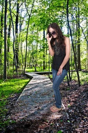 A beautiful woman wearing a pair of sunglasses Stock Photo
