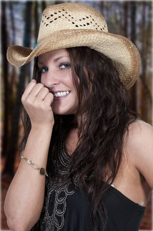 Beautiful young country girl woman wearing a stylish cowboy hat