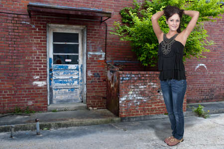 Young Beautiful Woman girl posing in front of a building Stock Photo - 13545413