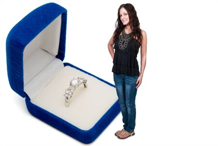 Beautiful woman standing next to a wedding ring in a jewelers box Stock Photo - 13544779