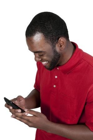 テキスト メッセージの携帯電話を使用して黒いアフリカ系アメリカ人男性 写真素材