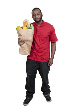 Handsome young man doing his grocery shopping Stock Photo - 13544702