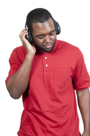 Handsome man listening to a set of headphones photo