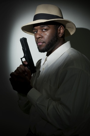 law enforcer: Black African American police private detective man on the job with a gun