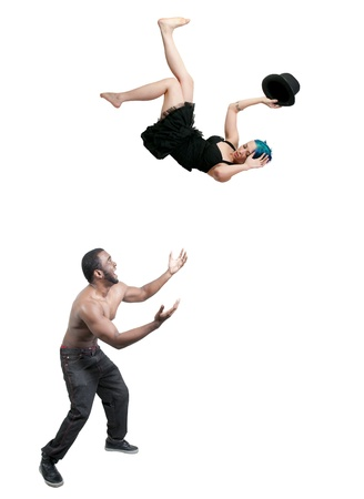 Handsome man catching a beautiful young woman falling through the sky Stock Photo