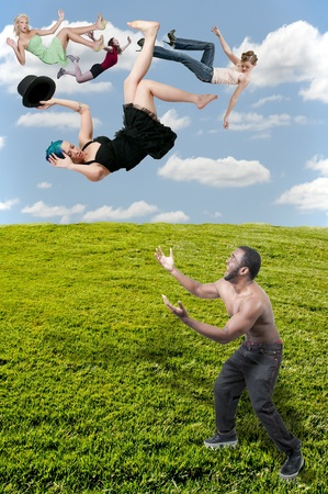 Handsome man catching a beautiful young woman falling through the sky photo
