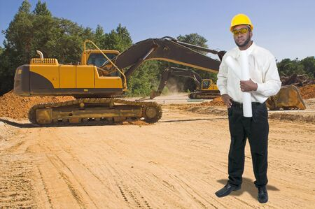 Balck African American male construction worker a job site with a backhoe photo