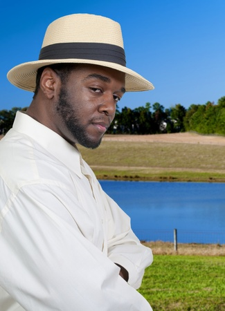 An attractive handsome African American black man in a fedora hat photo