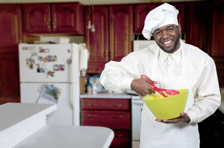 Black African American male chef showing his approval of the taste of food photo
