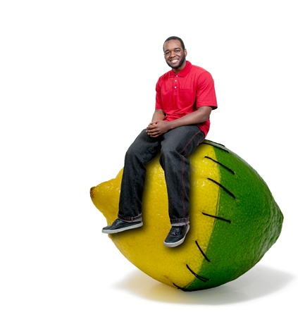 Black African American American man sitting on a lemon and a lime stitched together photo