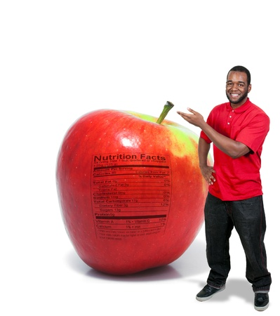 A handsome young man with an apple with a nutrition label photo