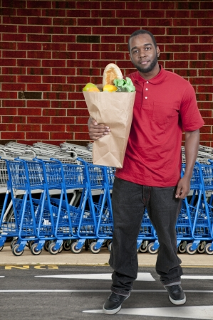 Handsome young man doing his grocery shopping photo
