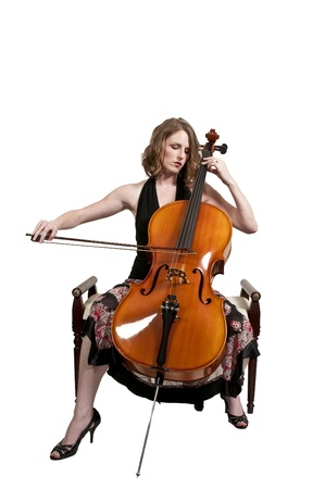 Beautiful woman cellist with her cello musical instrument