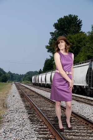 Beautiful young woman in a sleeveless mod dress photo
