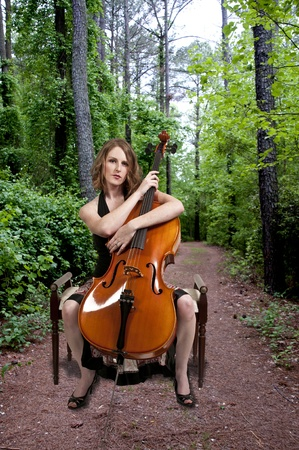 Beautiful woman cellist with her cello musical instrument photo