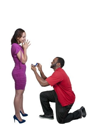 minority couple: Man with a wedding ring proposing marriage to a woman