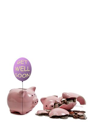 Broken piggy bank filled with loose change photo