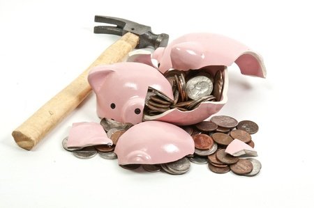 broke: Broken piggy bank filled with loose change