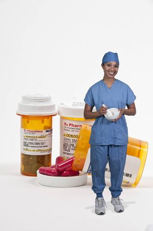 Woman doctor and bottle of prescription medicine pills for a medical patient photo
