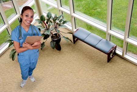 Beautiful black African American female doctor in scrubs photo