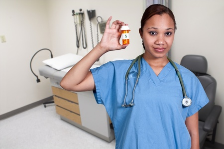 Black woman doctor holding a bottle of prescription pills in a bottle photo