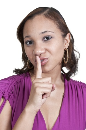 Black African American woman saying be quiet by saying shhh photo