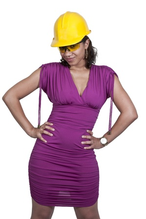 A black African American Woman Construction Worker wearing a hard hat and safety glasses photo