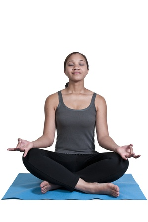 Beautiful black African American woman doing her Yoga exercises photo