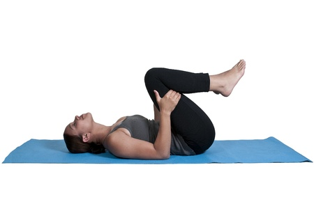 Beautiful black African American woman doing her Yoga exercises photo