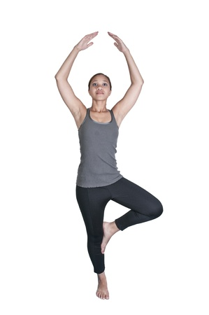 Beautiful black African American woman doing her Yoga stance exercises photo