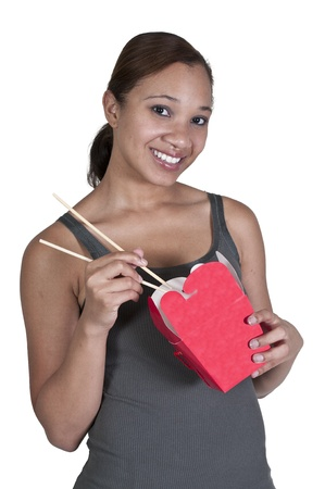 A beautiful black African American woman eating Chinese Japanese or Asian takeout food Stock Photo - 14880531