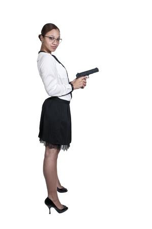poliziotta: Bella nero African American donna detective della polizia sul posto di lavoro con una pistola