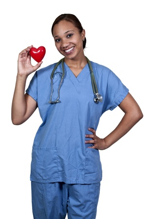 A female cardiologist woman doctor holding a red heart Stock Photo - 14878539