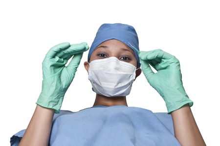 A beautiful young woman surgeon performing surgery Stock Photo - 14879932