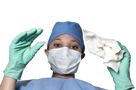 A beautiful young woman surgeon performing surgery photo