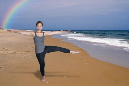 A beautiful woman doing her Yoga stance exercises photo