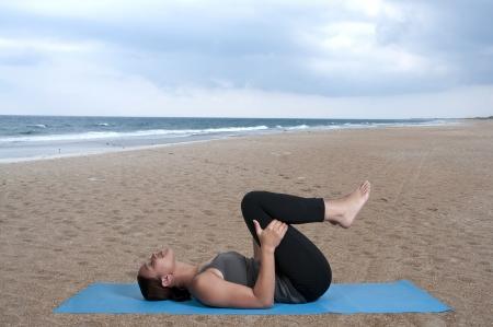 Beautiful black African American woman doing her Yoga exercises Stock Photo - 14880111