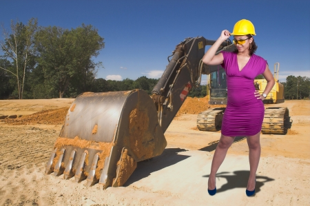 back hoe: A black African American Woman Construction Worker wearing a hard hat and safety glasses