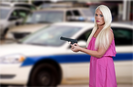 A beautiful police detective woman on the job with a gun Stock Photo - 14878409