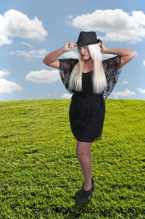 Beautiful young sexy blond haired woman posing Stock Photo - 14880595