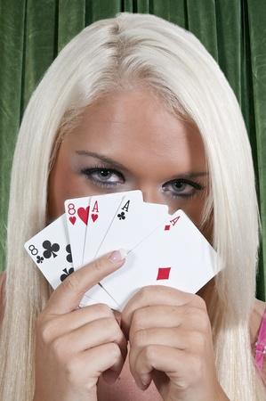 blonde minority: A beautiful woman playing cards - lady luck Stock Photo