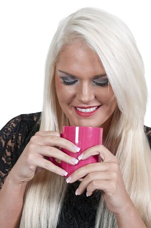 blonde minority: Beautiful young woman drinking and smelling coffee Stock Photo
