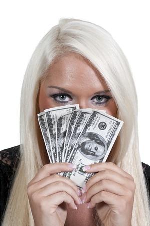 100 ドル札の完全な手を保持している美しい女性