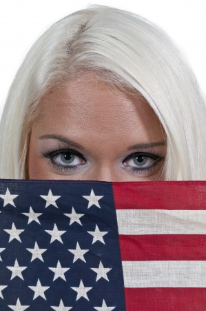 A beautiful young woman holding an American flag. photo