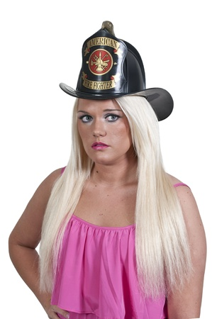 turnout gear: A beautiful woman firefighter at a fire Stock Photo